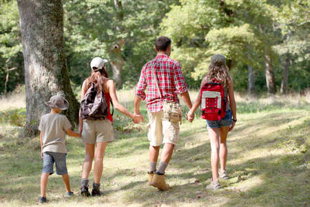 trek: Parents and children on a hiking day