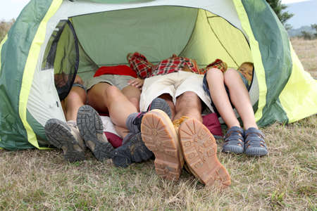 camping: View of people feet from outside a camp tent