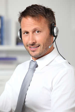 prospection: Closeup of businessman in the office with headphones Stock Photo