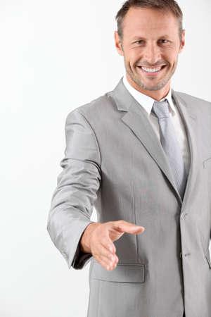 extending: Businessman extending hand towards camera