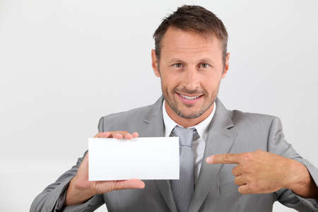 Businessman holding business card photo