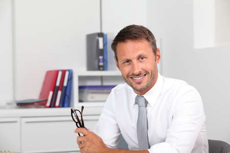 Closeup of smiling businessman in the office Stock Photo - 7954020