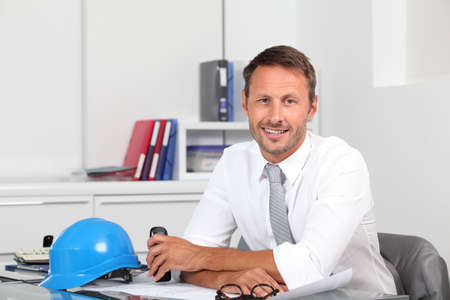 site manager: Site manager in the office with blue helmet