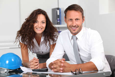 investors: Business poeple in the office working on building project Stock Photo