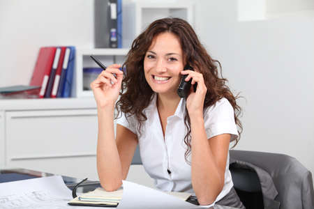 telephone saleswoman: Closeup of businesswoman in the office talking on the phone