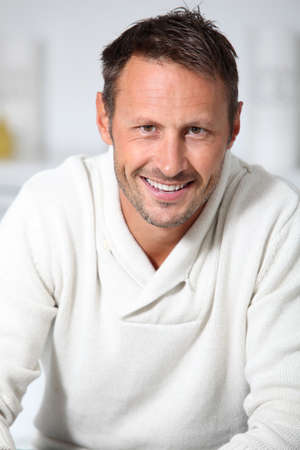 relaxed man: Closeup of hansdsome man with white sweater Stock Photo