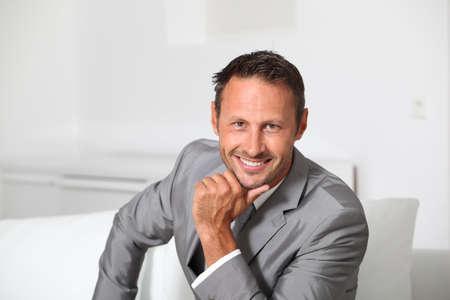 Closeup of businessman wearing grey suit photo