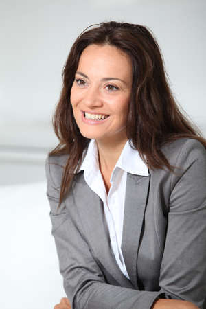 skirt suit: Beautiful smiling businesswoman  Stock Photo
