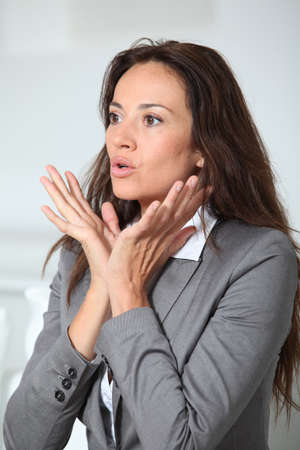 misunderstanding: Businesswoman with misunderstanding look Stock Photo