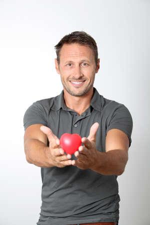 heartbreaker: Man holding red heart in his hands