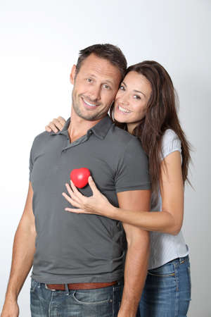 Couple on white background holding red hearts Stock Photo - 7954605