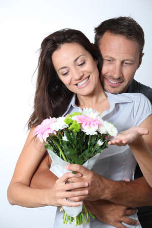 Man giving bunch of flowers to girlfriends Stock Photo - 7954567