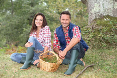 Couple in forest picking mushrooms in autumn Stock Photo - 7954866
