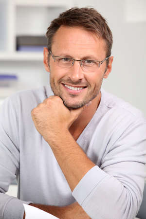caucasian man: Handsome man with eyeglasses on