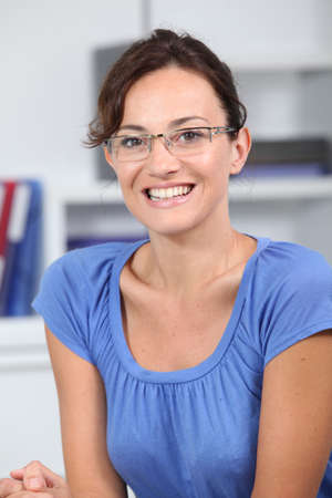 Closeup of beautiful woman with eyeglasses photo