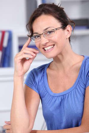 Closeup of beautiful woman with eyeglasses photo