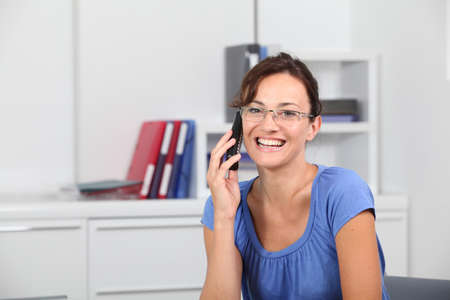 Closeup of beautiful woman with blue shirt photo