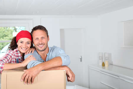 moving house: Closeup of couple resting on boxes Stock Photo