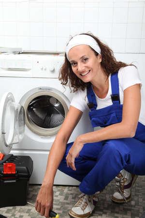 Plumber fixing broken washing machine
