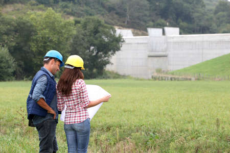Business people checking plan on construction site Stock Photo - 7954561