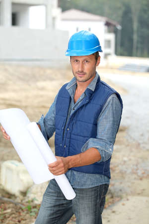 construction project: Businessman with helmet checking site under construction Stock Photo