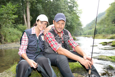 fisherwoman: Man and woman in river fly fishing