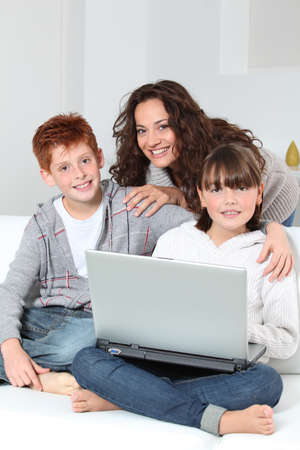 Mother and children surfing on internet photo