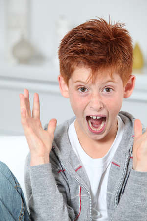 Young boy going crazy photo