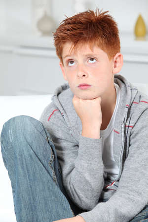 Young boy doing faces photo