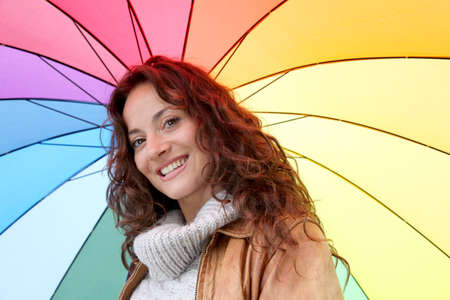 Beautiful smiling woman on a raining day photo