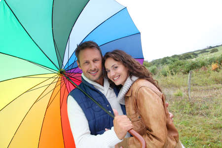 Smiling couple on a raining day photo
