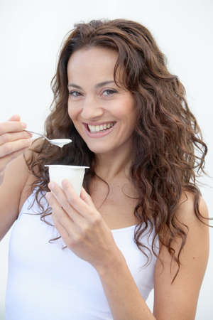 Closeup of beautiful woman eating yogurt Stock Photo - 7954583