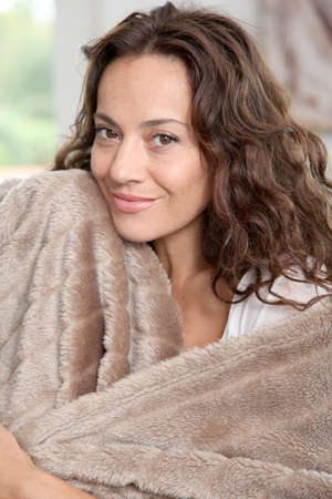 cocooning: Closeup of beautiful woman with fur