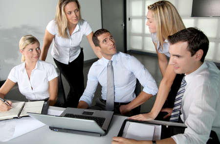 Group of business people meeting in the office Stock Photo - 8087345