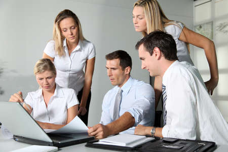 Group of business people meeting in the office Stock Photo - 8087359