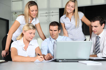 Group of business people meeting in the office Stock Photo - 8087439