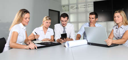 sales assistant: Group of business people meeting in the office