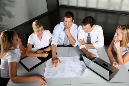Group of business people meeting in the office photo