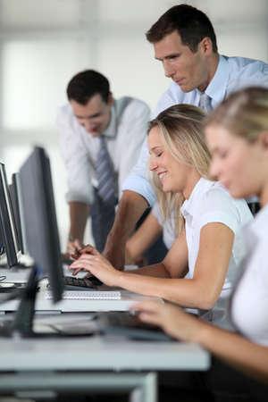 Business people working on computer Standard-Bild