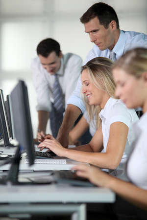 Business people working on computer photo