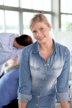 Closeup of blond woman attending training course photo