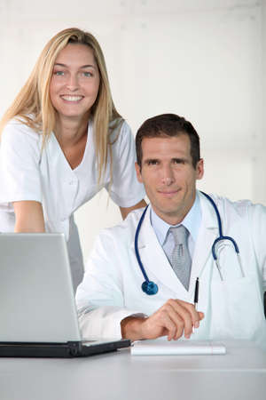 Closeup of doctor and nurse in the office photo