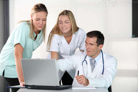 Closeup of doctor and nurses in the office photo