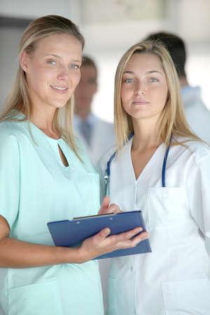Beautiful nurses standing in hospital corridor Stock Photo - 8087522