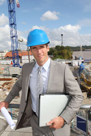 Businessman controlling site under construction Stock Photo - 8087549