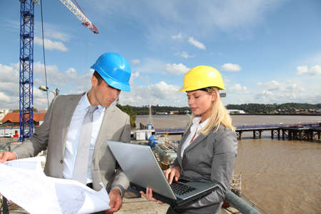 Architect and supervisor checking site under construction Stock Photo - 8087554