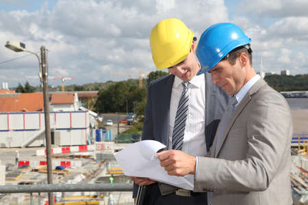 building site: Business people on construction site