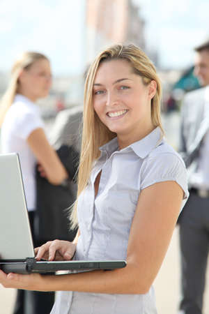 Blond businesswoman with laptop computer photo