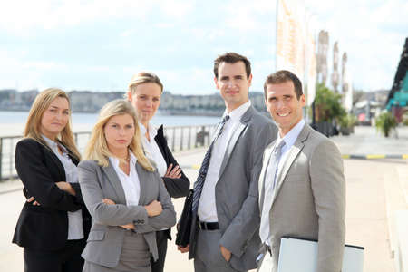 Group of business people standing outside a trade fair photo