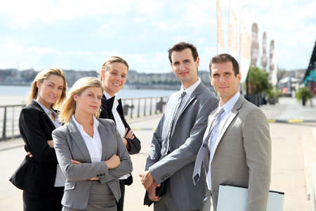 Group of business people standing outside a trade fair Imagens